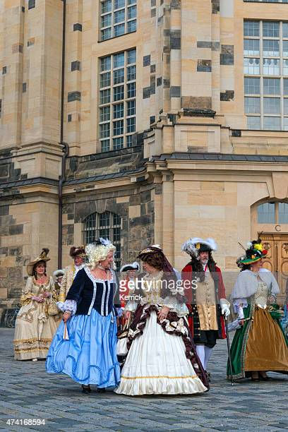 noble ladys in baroque clothes walking trough Dresden