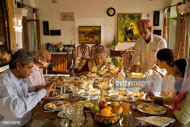 Nobleman Nahar Singhji also known as Rao Saheb with his wife Rani Saheb son daughterinlaw and grandaughter enjoy a relaxed breakfast in their lake...