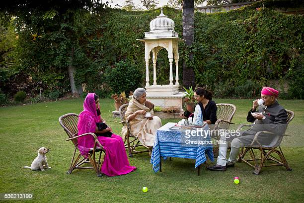 Nobleman Nahar Singhji also known as Rao Saheb with his wife Rani Saheb daughterinlaw and grandaughter enjoy a genteel and relaxed cup of tea on the...