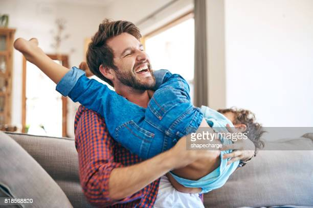 nobody has more fun than a dad and his son - wrestling stock pictures, royalty-free photos & images