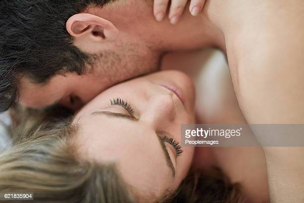 nobody is immune to the neck kiss - heterosexual couple photos stock photos and pictures