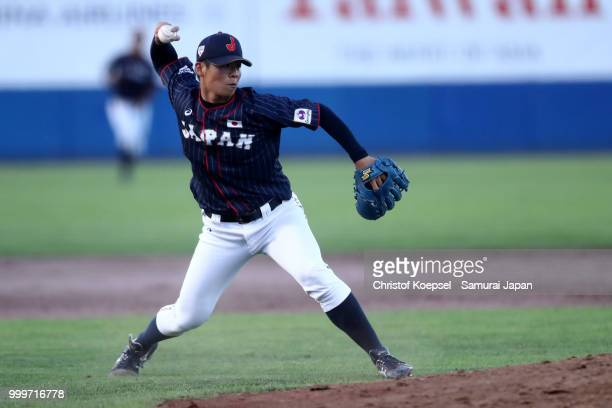 Noboru Shimizu of Japan throws the ball to the first base too end the fifth inning during the Haarlem Baseball Week game between Cuba and Japan at...