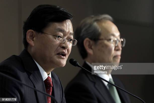 Nobuaki Kurumatani incoming chief executive officer and chairman of Toshiba Corp left speaks while Satoshi Tsunakawa outgoing chief executive officer...