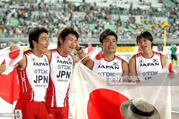 Nobuharu Asahara Naoki Tsukahara Shingo Suetsugu and Shinji Takahira of Japan react after competing in the Men's 100m x4 relay final during day eight...