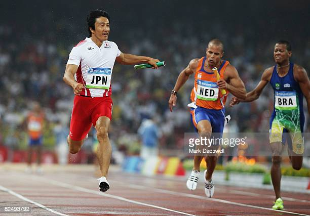 Nobuharu Asahara of Japan Caimin Douglas of Netherlands and Sandro Viana of Brazil compete in the Men's 4 x 100m relay Heats held at the National...