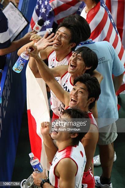 Nobuharu Asahara Shinji Takahira Shingo Suetsugu and Naoki Tsukahara of Japan celebrate breaking the Japan record in the Men's 4 x 100m Relay on day...