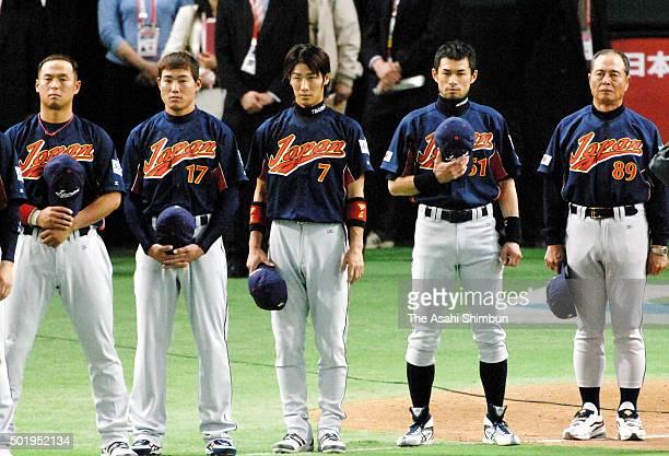 Nobuhiko Matsunaka Kosuke Fukudome Tsuyoshi Nishioka Ichiro Suzuki and head coach Sadaharu Oh of Japan line up for the national anthem prior to the...