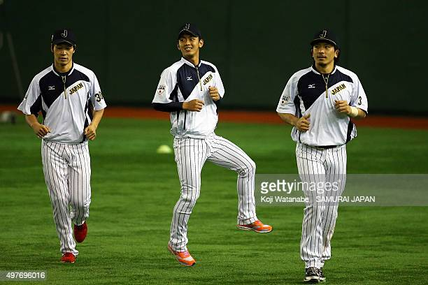 Nobuhiro Matsuda and Kenta Imamiya of Japan in action during a training session ahead of the WBSC Premier 12 semi final match against South Korea at...
