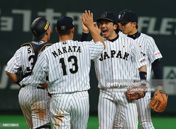 Nobuhiro Matsuda and Sho Nakata of Japan high five after their team's 50 win in the WBSC Premier 12 match between Japan and South Korea at the...