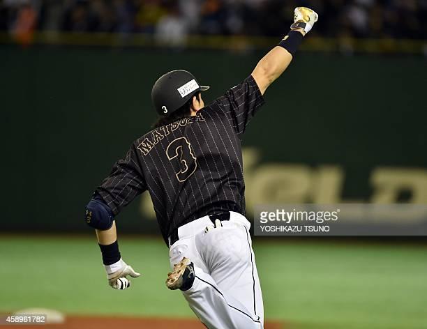 Nobuhiro Matsuda of Fukuoka SoftBank Hawks gestures as he hits a homerun during an exhibition game between Major League Baseball Allstars and a team...