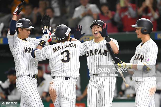 Nobuhiro Matsuda of Japan celebrates with his teammates after hitting a threerun homer in the fifth inning of the World Baseball Classic Pool B Game...