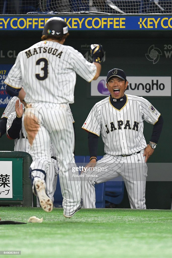 Nobuhiro Matsuda #3 of Japan celebrates with manager Hiroki Kokubo after hitting a three-run homer in the fifth inning of the World Baseball Classic Pool B Game One between Cuba and Japan at Tokyo Dome on March 7, 2017 in Tokyo, Japan.