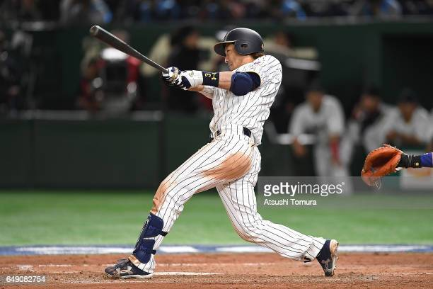 Nobuhiro Matsuda of Japan hits a threerun homer in the fifth inning of the World Baseball Classic Pool B Game One between Cuba and Japan at Tokyo...
