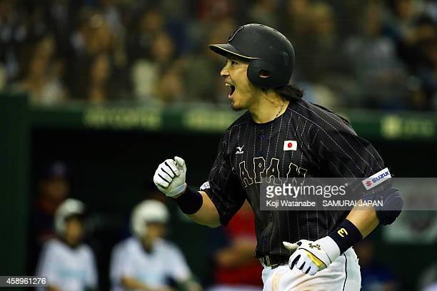 Nobuhiro Matsuda of Samurai Japan celebrates after hitting a solo home run in the eighth inning during the game two of Samurai Japan and MLB All...