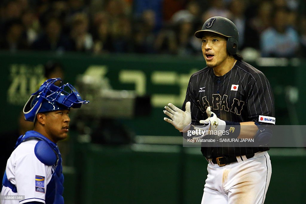 Nobuhiro Matsuda #3 of Samurai Japan celebrates after hitting a solo home run as Salvador Perez #13 of Kansas City Royals looks on in the eighth inning during the game two of Samurai Japan and MLB All Stars at Tokyo Dome on November 14, 2014 in Tokyo, Japan.