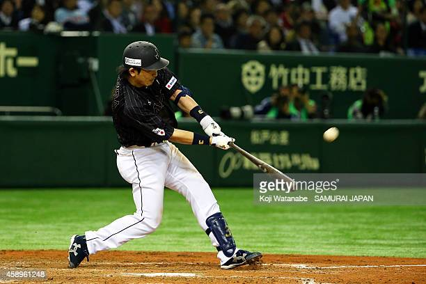 Nobuhiro Matsuda of Samurai Japan hits a solo home run in the eighth inning during the game two of Samurai Japan and MLB All Stars at Tokyo Dome on...