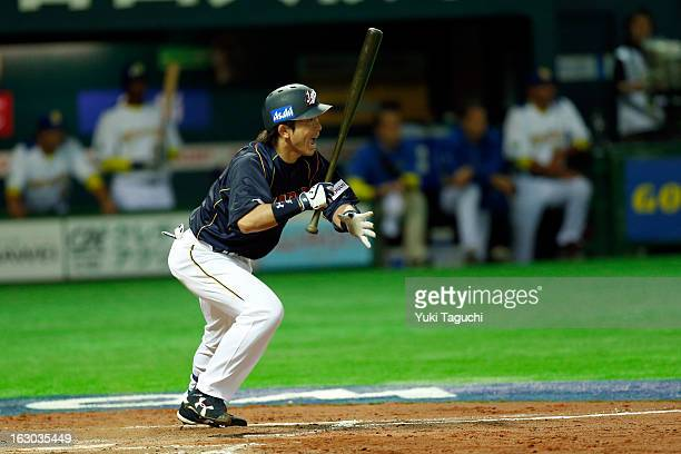 Nobuhiro Matsuda of Team Japan hits a RBI single in the top of the eighth inning during Pool A Game 1 between Team Japan and Team Brazil during the...