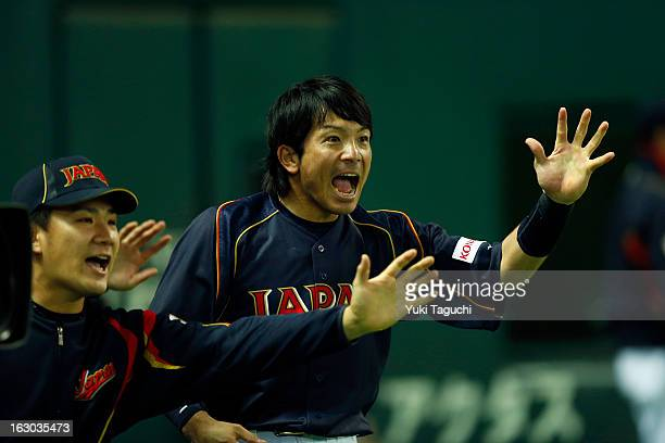 Nobuhiro Matsuda of Team Japan reacts to Hirokazu Ibata game tying single in the top of the eighth inning during Pool A Game 1 between Team Japan and...