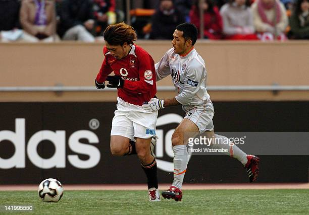 Nobuhisa Yamada of Urawa Red Diamonds and Teruyoshi Ito of Shimizu SPulse compete for the ball during the 85th Emperor's Cup final match between...