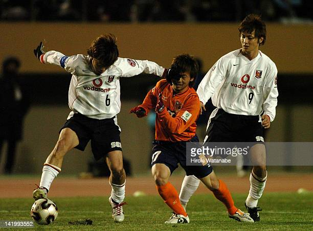 Nobuhisa Yamada of Urawa Red Diamonds and Yusuke Shimada of Omiya Ardija compete for the ball during the 85th Emperor's Cup semi final match between...