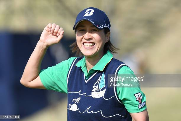 Nobuko Kizawa of Japan celebrates after making her birdie putt on the 18th hole during the second round of the CyberAgent Ladies Golf Tournament at...