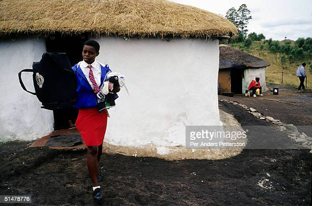 Nobule Ngema gathers her traditional clothing as she prepares to travel to the annual Reed Dance on September 10 2004 in Ngudwini village in rural...