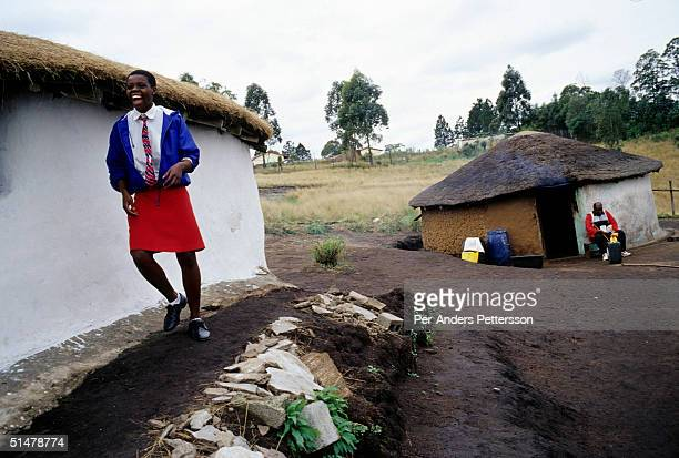 Nobule Ngema smiles as she's excited about traveling to the annual Reed Dance on September 10 2004 in Ngudwini village in rural Natal South Africa...