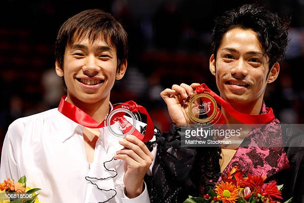 Nobunari Oda of Japan and Daisuke Takahashi of Japan pose for photographers after the medal ceremony during Skate America at Rose Garden Arena on...