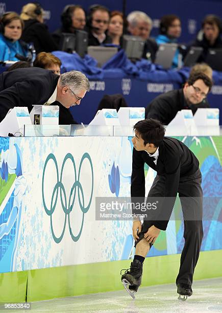 Nobunari Oda of Japan ties his laces as he competes in the men's figure skating free skating on day 7 of the Vancouver 2010 Winter Olympics at the...