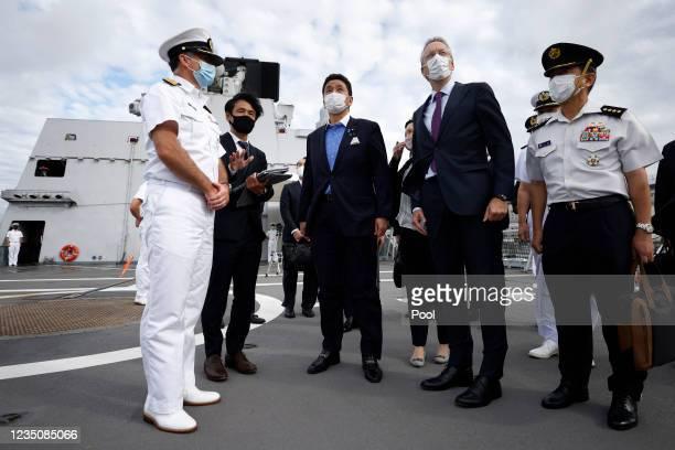 Nobuo Kishi, Japan's Defence Minister, centre, Peter van der Vliet, Netherlands' ambassador to Japan, second right, and Rick Ongering, commanding...