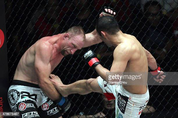 Nobutatsu Suzuki of Japan in action against Brock Larson of the United States during the One FC War of Nations Welterweight World Championship bout...