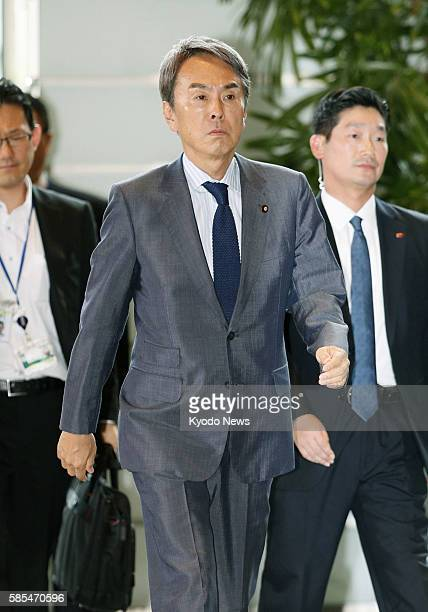 Nobuteru Ishihara retained as minister in charge of economic revitalization in a Cabinet reshuffle enters the prime minister's office in Tokyo on Aug...
