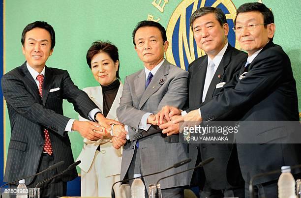 Nobuteru Ishihara Yuriko Koike former foreign minister Taro Aso former foreign minister Taro Aso and Kaoru Yosano join hands before an open debate by...