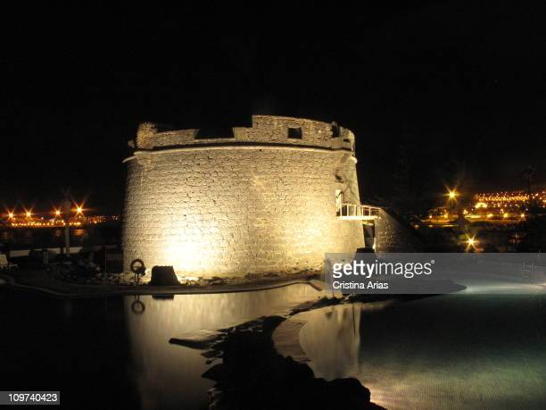 Nocturn view of the castle of Caleta de Fuste a small fortification of the 17th century which is located next to the marina and currently surrounded...