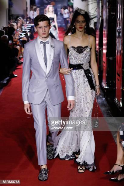 Noe Elmaleh and Yvonne walks the runway at the Dolce Gabbana secret show during Milan Fashion Week Spring/Summer 2018 at Bar Martini on September 23...