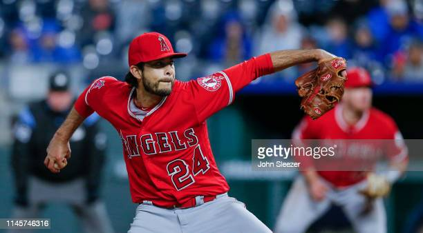 Noe Ramirez of the Los Angeles Angels of Anaheim pitches in the seventh inning during the game against the Kansas City Royals at Kauffman Stadium on...