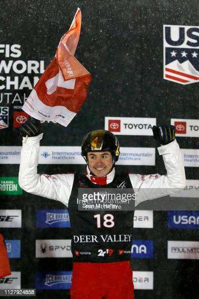 Noe Roth of Switzerland in third place celebrates on the podium during the Men's Aerials Final at the FIS Freestyle Ski World Championships on...
