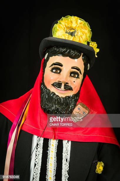 Noe Vazquez poses in his Catrines costume for the carnival in Tlaxcala Mexico on February 13 2018 The satirical costumes and masks were originally...