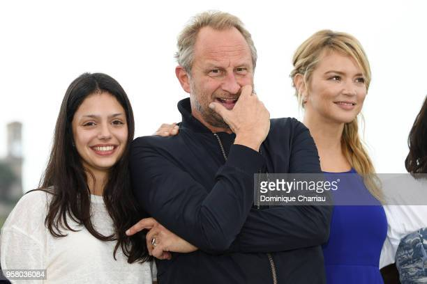 Noee AbitaBenoit Poelvoorde and Virginie Efira attend the photocall for the Sink Or Swim during the 71st annual Cannes Film Festival at Palais des...