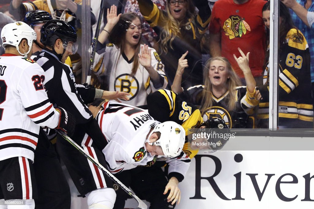Noel Acciari #55 of the Boston Bruins and Connor Murphy #5 of the Chicago Blackhawks fight during the third period of their preseason game at TD Garden on September 25, 2017 in Boston, Massachusetts. The Bruins defeat the Blackhawks 4-2.