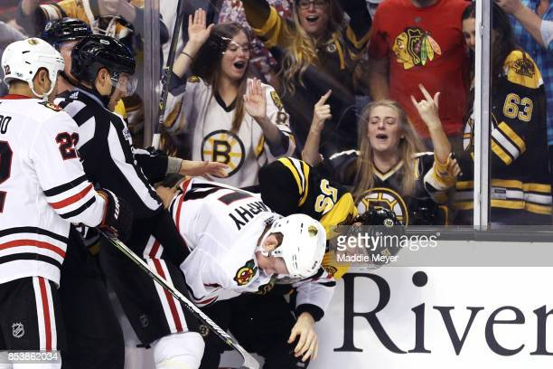 Noel Acciari of the Boston Bruins and Connor Murphy of the Chicago Blackhawks fight during the third period of their preseason game at TD Garden on...