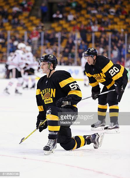 Noel Acciari of the Boston Bruins and Lee Stempniak stretch before the game against the Chicago Blackhawks at TD Garden on March 3 2016 in Boston...