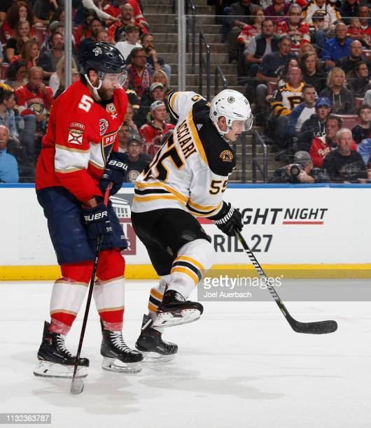 Noel Acciari of the Boston Bruins attempts to get into position for a tip in attempt in front of Aaron Ekblad of the Florida Panthers at the BBT...