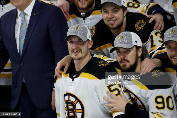 Noel Acciari of the Boston Bruins celebrates with his teammate Marcus Johansson after defeating the Carolina Hurricanes in Game Four to win the...