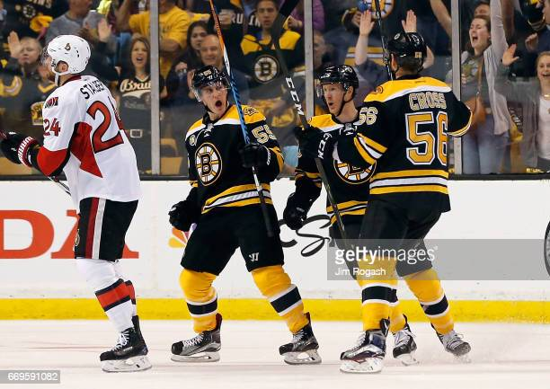 Noel Acciari of the Boston Bruins celebrates with teammates after his goal in the second period against the Ottawa Senators in Game Three of the...