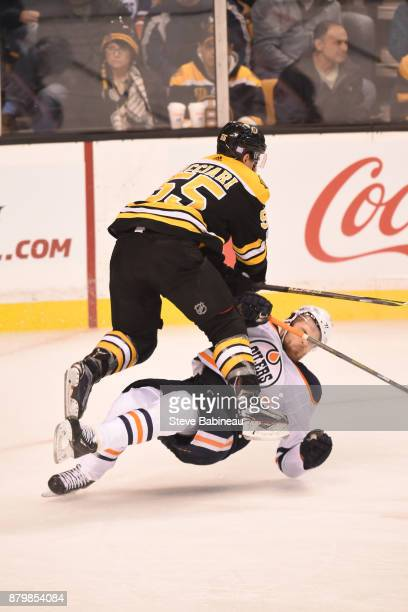 Noel Acciari of the Boston Bruins checks against Leon Draisaitl of the Edmonton Oilers at the TD Garden on November 26 2017 in Boston Massachusetts