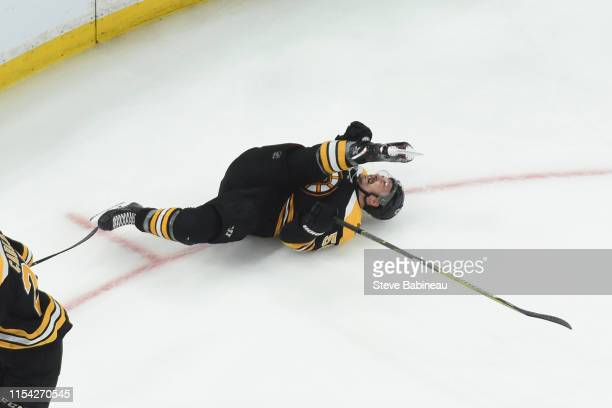 Noel Acciari of the Boston Bruins falls on the ice against the St Louis Blues in Game Five of the Stanley Cup Final during the 2019 NHL Stanley Cup...