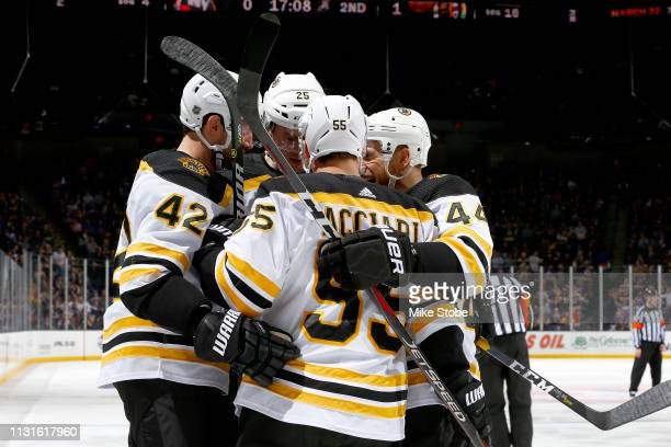 Noel Acciari of the Boston Bruins is congratulated by his teammates after scoring a second period goal against the New York Islanders at NYCB Live's...