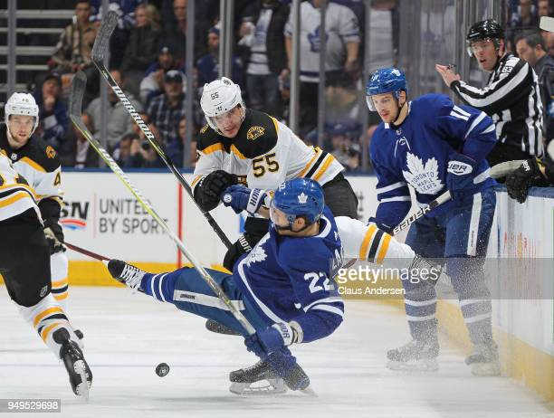 Noel Acciari of the Boston Bruins levels Nikita Zaitsev of the Toronto Maple Leafs in Game Four of the Eastern Conference First Round in the 2018...
