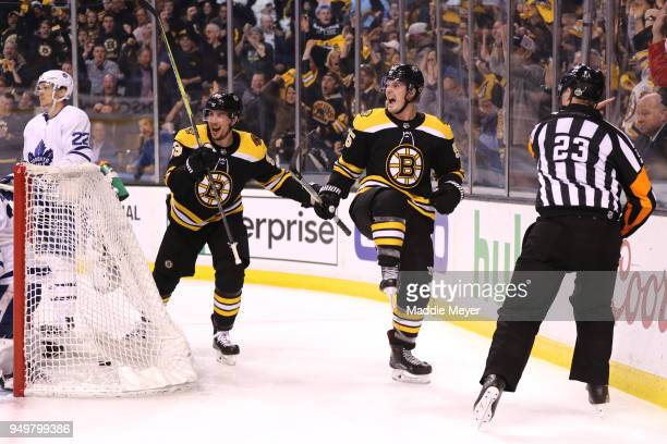 Noel Acciari of the Boston Bruins right celebrates with Tim Schaller after scoring a goal against the Toronto Maple Leafs during the third period of...